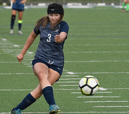 Enid's Edith Vega puts a shot on goal against Bartlesville Friday April 5, 2019 at D. Bruce Selby Stadium. (Billy Hefton / Enid News & Eagle)