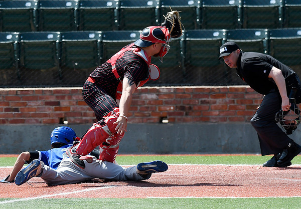 NOC Enid catcher, Garrett Misenheimer, holds up his glove to show the umpire the ball after tagging out Pratt CC's Elerie Rivera at home plate Tuesday April 2, 2019 at David Allen Memorial Ballpark. (Billy Hefton / Enid News & Eagle)