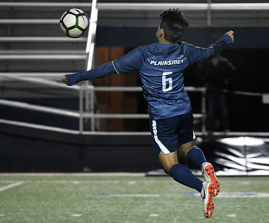 Enid's Btayan Rodriguez takes flight to control the ball against Bixby Friday April 12, 2019 at D. Bruce Selby Stadium. (Billy Hefton / Enid News & Eagle)