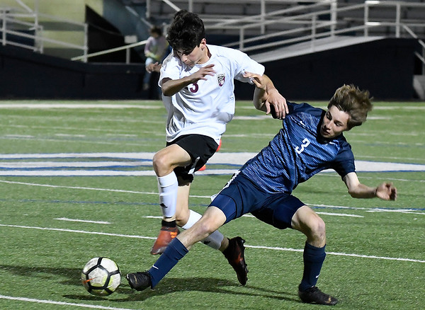 Enid's Chase King competes for the ball with Jenks' Will Edwards Tuesday April 16, 2019 at D. Bruce Selby Stadium. (Billy Hefton / Enid News & Eagle)