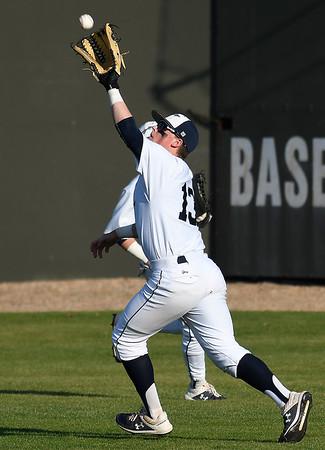 Enid's Brett Russell makes a running catch against Stillwater during the Gladys Winters Tournament Thursday April 4, 2019 at David Allen Memorial Ballpark. (Billy Hefton / Enid News & Eagle)
