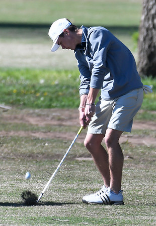 Enid High's Ethan Armstrong hits from the 9th fairaway Monday April 15, 2019 during the Enid Invitational at Meadowlake Golf Course. (Billy Hefton / Enid News & Eagle)