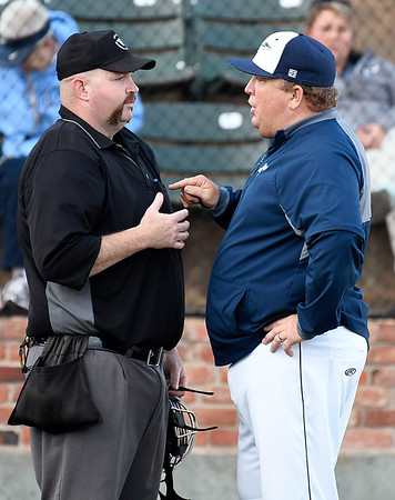Enid head coach, Brad Gore, discusses an issue with the home plate during a game against Stillwater in the Gladys Winters Tournament Thursday April 4, 2019 at David Allen Memorial Ballpark. (Billy Hefton / Enid News & Eagle)