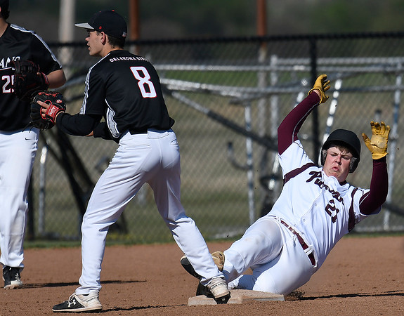 Pioneer's Payton Meyer slides into second with a double against Oklahoma Bible Academy's Connor Colby during the district tournament Friday April 19, 2019 at Pioneer High School. (Billy Hefton / Enid News & Eagle)