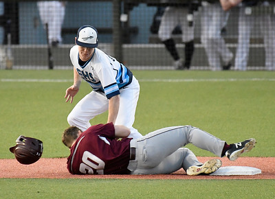 Enid's Ambren Voitik tags out  Jenks' Jackson Jeffries trying to steal second base Tuesday April 9, 2019 at David Allen Memorial Ballpark. (Billy Hefton / Enid News & Eagle)
