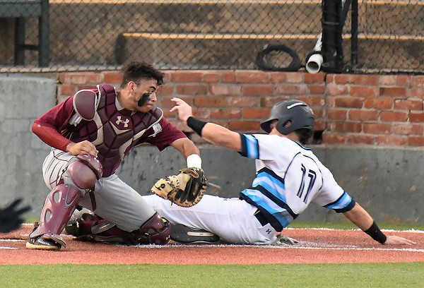 Enid's Hayden Priest slides into home ahead of the tag from Jenks' Geo Blackshaw Tuesday April 9, 2019 at David Allen Memorial Ballpark. (Billy Hefton / Enid News & Eagle)