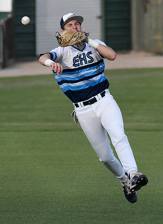 Enid's Connor Gore makes an off balance throw to first against Jenks Tuesday April 9, 2019 at David Allen Memorial Ballpark. (Billy Hefton / Enid News & Eagle)