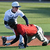 Enid's Kade Goeke tags out Union's Brody Briggs during the Gladys Winters Tournament Thursday, April 1, 2021 at David Allen Memorial Ballpark. (Billy Hefton / Enid News & Eagle)
