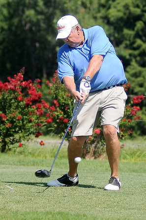 Freddie Forbes, from Stillwater, drives his shot from the No. 5 tee off during the PGA Senior South Central Sectional Tournament at Oakwood Country Club Monday, August 5, 2013. (Staff Photo by BONNIE VCULEK)