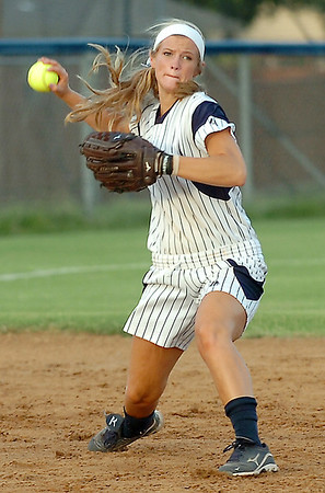 haven Bay makes a throw to first against Midwest City Tuesday at Pacer Field. (Staff Photo by BILLY HEFTON)