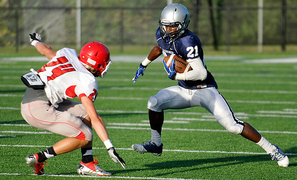 Marshawn Mills (21) gains yards after a catch against Yukon during a scrimmage last week. (Staff Photo by BILLY HEFTON)