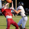 A Kremlin-Hillsdale defensive back breaks up a pass intended for a Pond Creek-Hunter receiver during a 5-team football scrimmage at Jet Friday, August 23, 2013. (Staff Photo by BONNIE VCULEK)