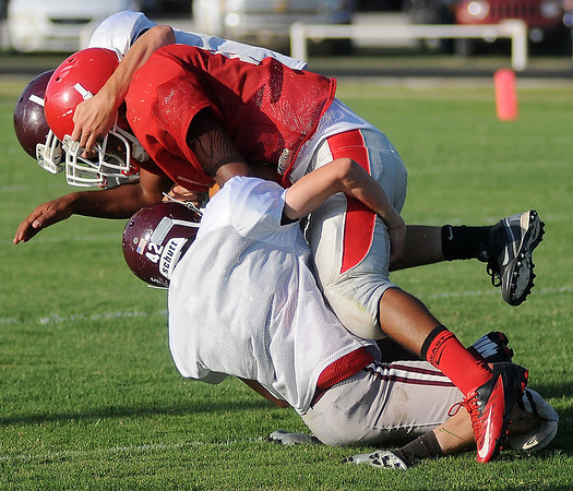 Medford's Ryan Banks fights for extra yardage against Waynoka during a pre-season scrimmage at DCLA High School in Lamont Friday, August 30, 2013. (Staff Photo by BONNIE VCULEK)