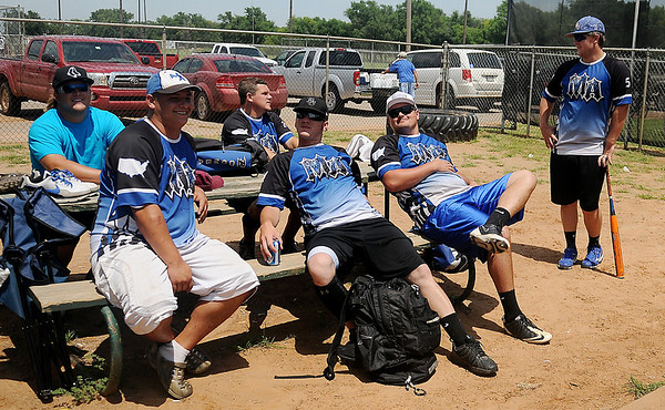Mid-America, from Enid, kick back as they wait for their second game to begin during the Oklahoma ASA Men's Slow Pitch Class F State Tournament at Kellet Park Saturday, August 3, 2013. (Staff Photo by BONNIE VCULEK)