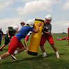 Players at Chisholm High School go through blocking drills Monday on the first official day of football practice. (Staff Photo by BILLY HEFTON)