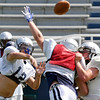 Christian Voitik throws a pass during practice Friday on the first day in full pads. (Staff Photo by BILLY HEFTON)