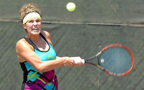 Jennilee Hockmeyer of the Enid Tennis Association returns a shot Sunday during the Larry McClure Cup at Crosslin Park. (Staff Photo by BILLY HEFTON)