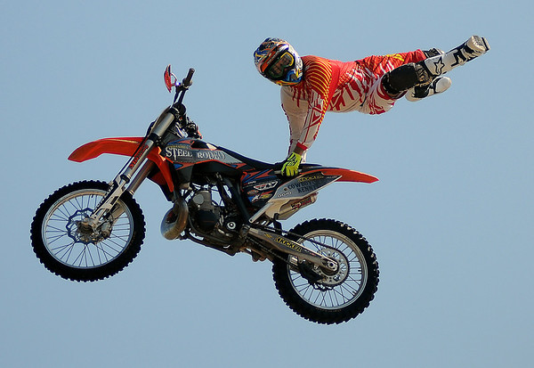 Cowboy Kenny Bartram performs a freestyle motorcross stunt during the Steel Rodeo Tour at the Greater Oklahoma Sportsman's Outdoor Expo at the Chisholm Trail Expo Center Saturday, August 24, 2013. (Staff Photo by BONNIE VCULEK)