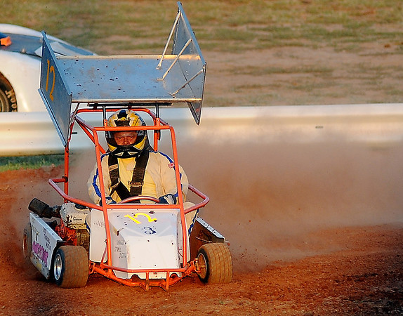 A go cart driver entertains the crowd while fans wait for the Enid Speedway races to begin Saturday, August 24, 2013. (Staff Photo by BONNIE VCULEK)