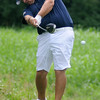 Josh Bugg tees off during the Wheat Capital Golf Tournament championship flight round at Meadowlake Golf Course Saturday, August 3, 2013. (Staff Photo by BONNIE VCULEK)
