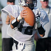 Timberlake's Bradon Buller looks for an open receiver during the 5-team football scrimmage at Jet Friday, August 23, 2013. (Staff Photo by BONNIE VCULEK)
