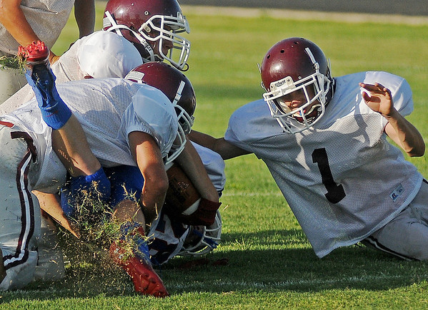 Waynoka tackles a Deer Creek-Lamont runner during the Eagle's scrimmage Friday, August 30, 2013. (Staff Photo by BONNIE VCULEK)