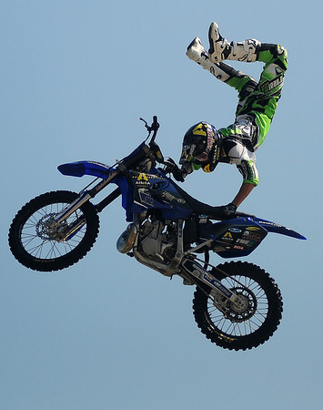 Matt Buyten performs a freestyle motor cross stunt during the Steel Rodeo Tour at the Greater Oklahoma Sportsman's Outdoor Expo at the Chisholm Trail Expo Center Saturday, August 24, 2013. (Staff Photo by BONNIE VCULEK)