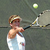 Jan Hill of the Enid Tennis Association returns a shot Sunday during the Larry McClure Cup at Crosslin Park. (Staff Photo by BILLY HEFTON)