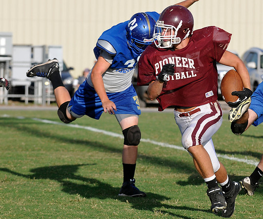 Pioneer's Chase Courter runs the ball against Newkirk Thursday during a scrimmage at Pioneer High School. (Staff Photo by BILLY HEFTON)