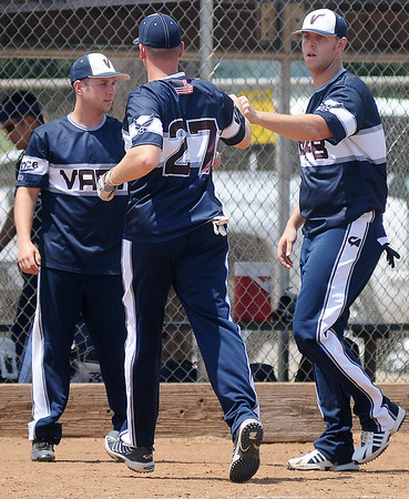 Vance AFB celebrates after a 3-run home run by John Stock (27) during the Oklahoma ASA Men's Slow Pitch Class F State Tournament at Kellet Park Saturday, August 3, 2013. (Staff Photo by BONNIE VCULEK)