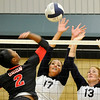 Enid's Grace Enmeier and Sarah Blakley go up to block a shot against Tulsa Union Thursday at Waller Middle School during the Pacers opening game of the season. (Staff Photo by BILLY HEFTON)