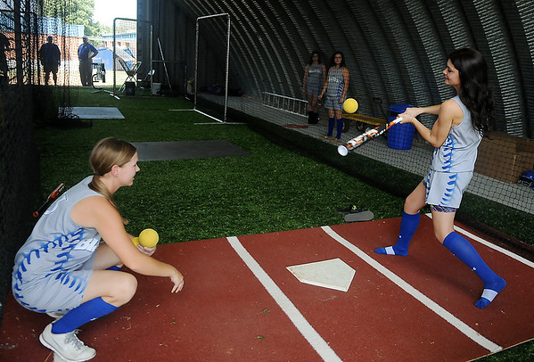Cammi Gregory connects with a soft toss by Ashle Bode during an indoor softball practice at Cimarron High School Thursday, August 29, 2013. The school's booster club, parents and grandparents collected donations and helped build the facility for the Trailblazers baseball and softball teams. (Staff Photo by BONNIE VCULEK)