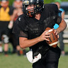 Buffalo's Kyle Hash rolls out of the pocket during the 5-team scrimmage at Jet Friday, August 23, 2013. (Staff Photo by BONNIE VCULEK)
