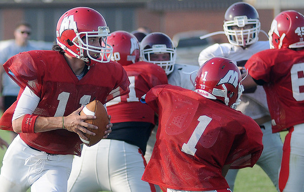 Medford's Alex Koehn rolls out of the pocket against Waynoka during the DCLA scrimmage at Lamont Friday, August 30, 2013. (Staff Photo by BONNIE VCULEK)