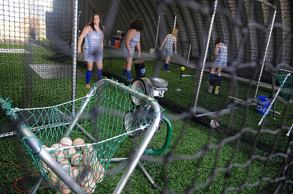 Cimarron High School Lady Blazers prepare for a softball practice in their new indoor batting cages Thursday, August 29, 2013. With the help of the Cimarron Booster Club, parents and grandparents, donations were collected for the netting, turf and other supplies. (Staff Photo by BONNIE VCULEK)