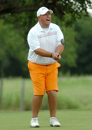 Josh Bugg reacts to missing a putt on the 10th green Sunday at Meadowlake Golf Course during the Wheat Capital Tournament. (Staff Photo by BILLY HEFTON)