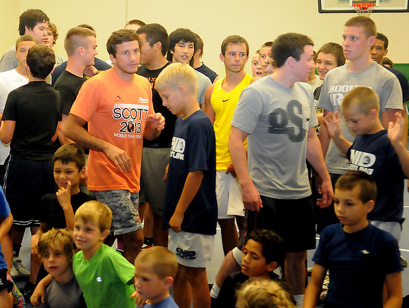 Coleman Scott (left in orange shirt), Olympic Bronze Medalist and OSU wrestling coach moves among the wrestlers during the Enid Camp for Champs Friday, August 2, 2013. (Staff Photo by BONNIE VCULEK)
