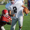 Waynoka's Christopher Castillo sprints up the field for long yardage against a Medford Cardinal during the DCLA Scrimmage Friday, August 30, 2013. (Staff Photo by BONNIE VCULEK)