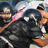 Buffalo defenders tackle a Timberlake running back during a scrimmage at Jet Friday, August 23, 2013. (Staff Photo by BONNIE VCULEK)