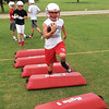 Players at Chisholm High School go through drills Monday on the first official day of football practice. (Staff Photo by BILLY HEFTON)