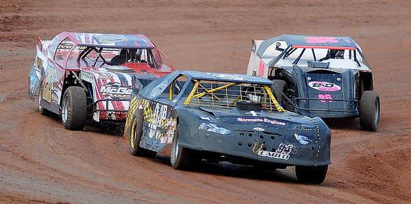 Cars jockey for position at the start of a play day race at Enid Speedway Saturday, August 3, 2013. The speedway season-opener is next week. (Staff Photo by BONNIE VCULEK)