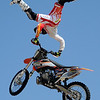 Cowboy Kenny Bartram, 10-time X-Games metalist, performs a freestyle motor cross stunt during the Steel Rodeo Tour at the Greater Oklahoma Sportsman's Outdoor Expo at the Chisholm Trail Expo Center Saturday, August 24, 2013. (Staff Photo by BONNIE VCULEK)