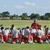 OBA head coach, Mark Boyd, addresses his team following the first day of practice Monday. (Staff Photo by BILLY HEFTON)