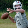 OBA's Baylor Boyd looks for a receiver during the first day of practice Monday. (Staff Photo by BILLY HEFTON)