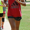 Enid's Abby Resendiz during a warm-up run at Crosslin Park Monday. (Staff Photo by BILLY HEFTON)
