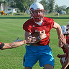 Chisholm's Brock Chance runs through drills during the first day of practice Monday. (Staff Photo by BILLY HEFTON)