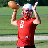 Chisholm's Taggart Brown throws a pass during the first day of practice Monday. (Staff Photo by BILLY HEFTON)