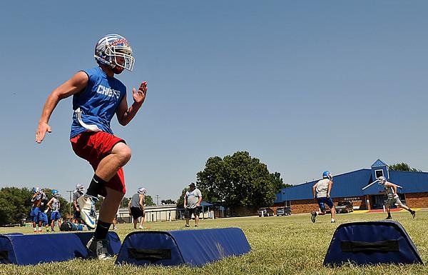 Waukomis' Riley Williams runs through drills during practice Thursday August 13, 2015. (Staff Photo by BILLY HEFTON)