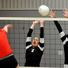 OBA's Brittney Stribel and Brooke Boydstun attempt to block the shot of Chisholm's Kaylee Petersen Tuesday August 23, 2016 at Chisholm Middle School. (Billy Hefton / Enid News & Eagle)