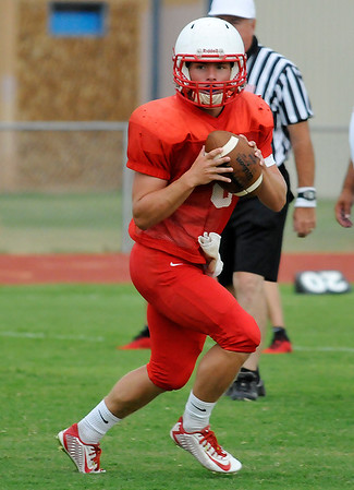 Chisholm's Hayden Winter looks for a receiver against Blackwell during a scrimmage Friday August 19, 2016 at Chisholm High School. (Billy Hefton / Enid News & Eagle)